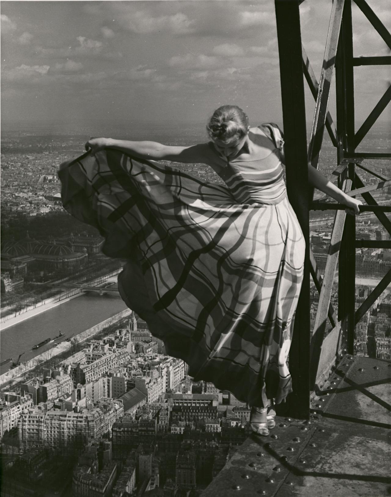 Lisa Fonssagrives wearing a Lucien Lelong dress high atop the Eiffel Tower by Erwin Blumenfeld 1939